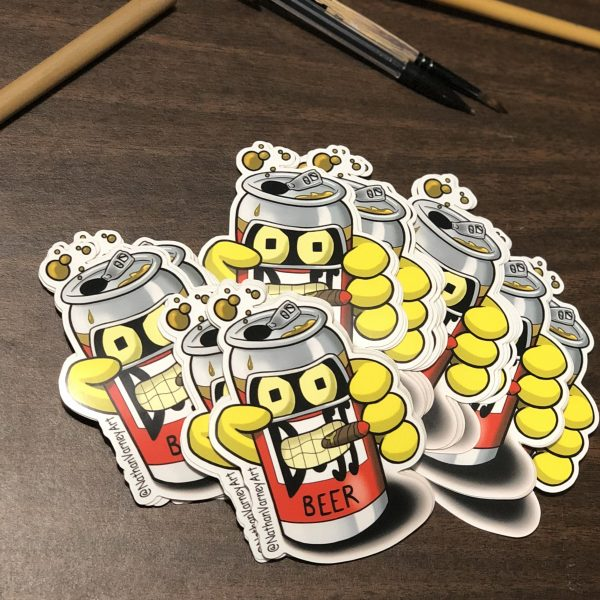 Recycled bender as a duff beer can stickers spread on table.